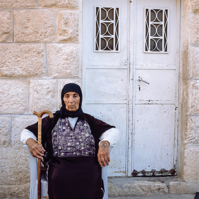 Palestinian woman in front of her house, Al-Nu'man
